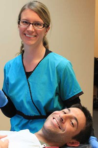 Shannon Brandstetter, RDH with smiling male patient in dental chair