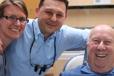 Hygienist Shannon and Dr. Gio with a valued patient of Winchester Dental
