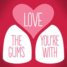 """Poster reading """"Love the gums you're with"""""""