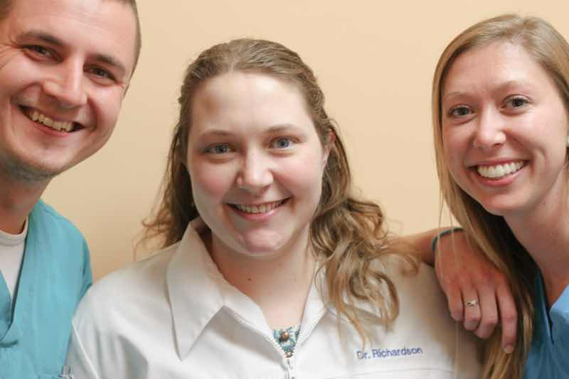 Dr. Richardson with her dental assistants, Rob and Sam