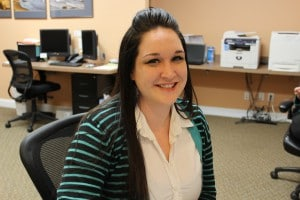 Patient Coordinator Mollie Schlegel at the Winchester Dental reception desk