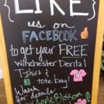 Chalkboard in waiting area promoting Winchester Dental Facebook page