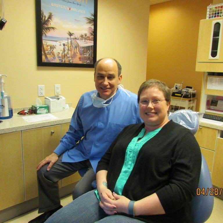 Dr. Frank Mitchell, DDS with American Dream Makeover recipient Carrie Brannan