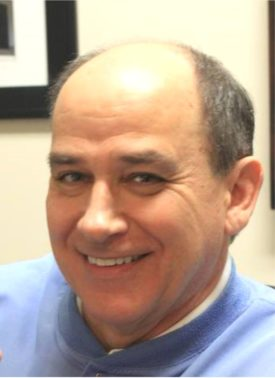 Dr. Frank Mitchell, DDS, smiling