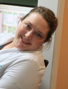 Closeup of Dr. Kelly Richardson, DDS, leaning out of office doorway