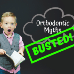 "Young boy holding a book, looking surprised beside text reading ""Orthodontic Myths BUSTED!"" (Photo credit: Ben White on Unsplash)"