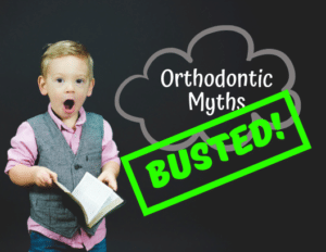 """Young boy holding a book, looking surprised beside text reading """"Orthodontic Myths BUSTED!"""" (Photo credit: Ben White on Unsplash)"""