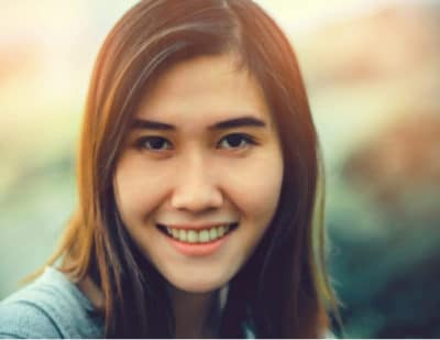 Image of young woman smiling. A healthy mouth is important for a healthy life!