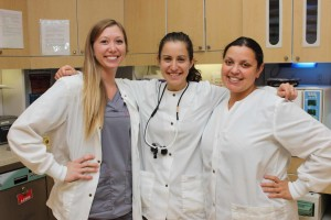 Dental assistant Samantha Ruble with Laura Steinmetz, RDH and Mistie Dodson, RDH in Winchester Dental's lab