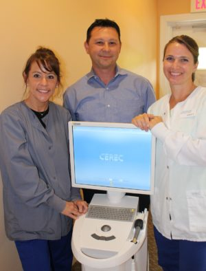 Dr. Gio Iuculano and dental assistants with CEREC unit for implant planning