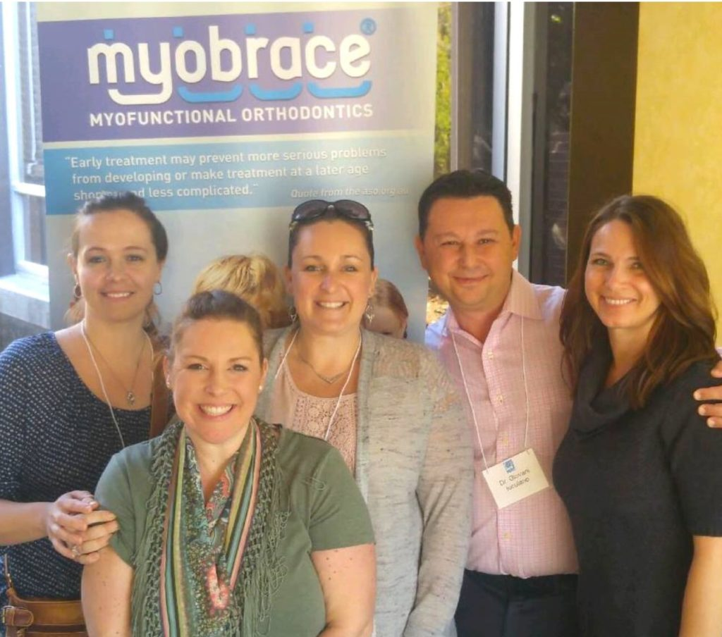 Winchester Dental team members in front of Myobrace sign